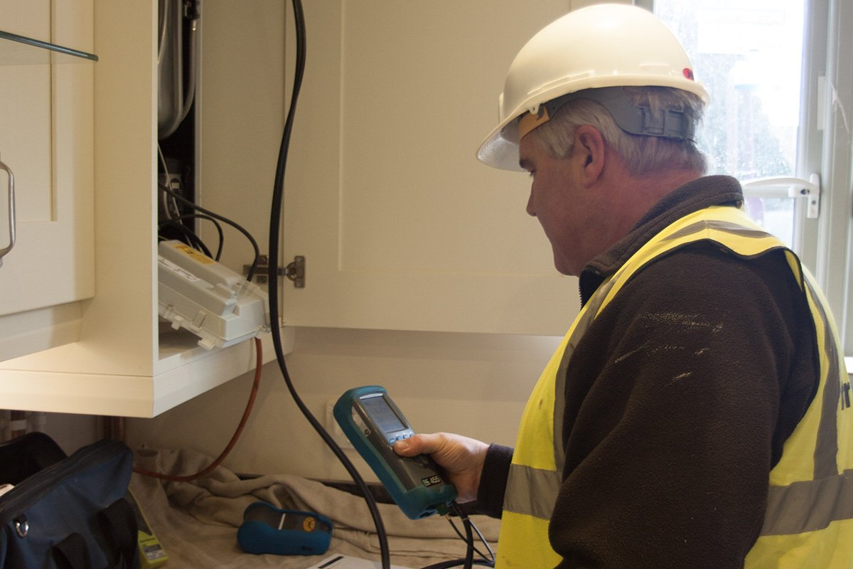 britchard's worker configuring boiler settings